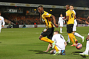 Cambridge United Sullay Kaikai is tackled by Manchester United's Phil Jones during the The FA Cup match between Cambridge United and Manchester United at the R Costings Abbey Stadium, Cambridge, England on 23 January 2015. Photo by Phil Duncan.