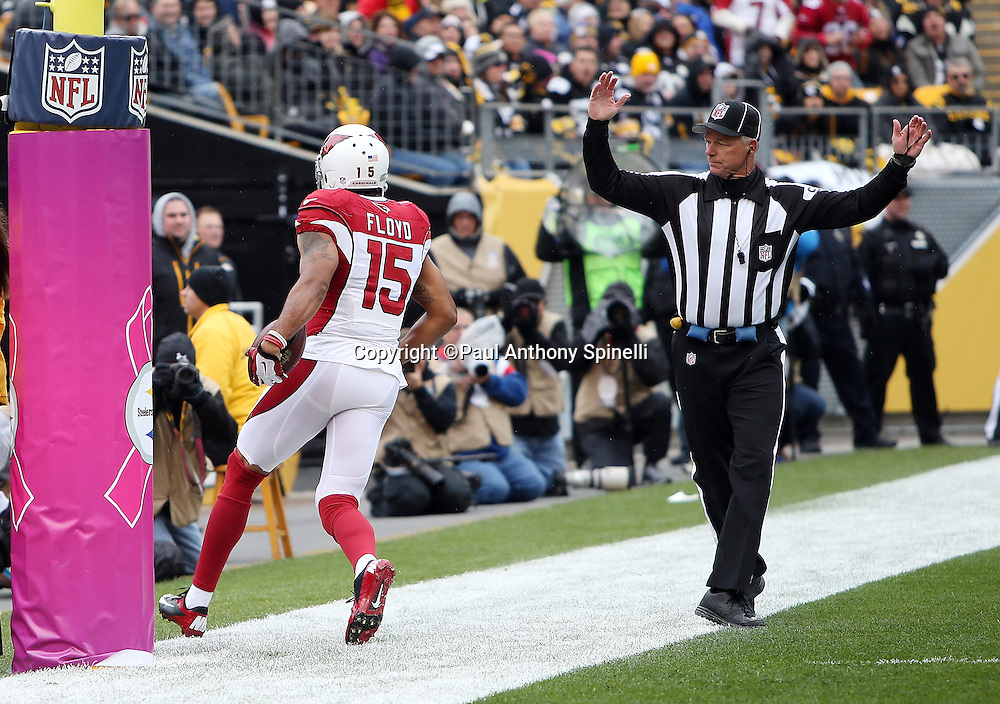An official signals touchdown as Arizona Cardinals wide receiver Michael Floyd (15) catches a 3 yard touchdown pass for a 7-0 first quarter lead during the 2015 NFL week 6 regular season football game against the Pittsburgh Steelers on Sunday, Oct. 18, 2015 in Pittsburgh. The Steelers won the game 25-13. (©Paul Anthony Spinelli)