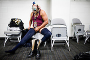One of  the Lucha Libre AAA Psycho Clowns prepares for a match in San Jose, CA March 29, 2009.