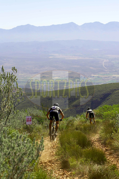 WESTERN CAPE, SOUTH AFRICA -  30 March 2008, Stefan Sahm leads Bulls teammate Karl Platt down the Gamtaskloof during stage two of the 2008 Absa Cape Epic Mountain Bike stage race from Saasveld Campus Nelson Mandela Metropolitan University in George to Calitzdorp Spa, Calitzdorp in the Western Cape, South Africa..Photo by Gary Perkin/SPORTZPICS