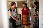 Tamsin Greig, an actress from the United Kingdom, looks around the shelter home as she speaks with Oasis staff in Nirmal Bhavan, a rehabilitation home for trafficked and rescued girls run by Tearfund partner NGO Oasis India, in Mumbai, Maharashtra, India on 20 February 2014. Photo by Suzanne Lee/Tearfund
