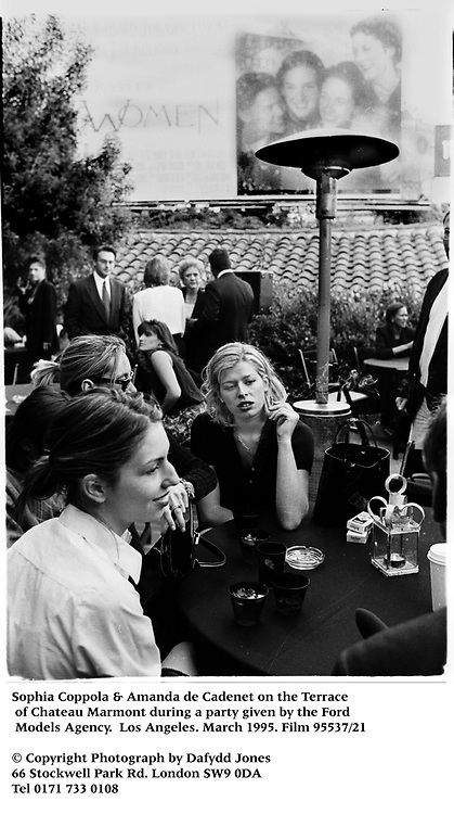 Sophia Coppola & Amanda de Cadenet on the Terrace of Chateau Marmont during a party given by the Ford Models Agency.  Los Angeles. March 1995. Film 95537/21<br />
