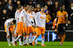 Blackpool players walk back after a goal for Midfielder Thomas Ince (ENG) during the second half of the match - Photo mandatory by-line: Rogan Thomson/JMP - Tel: Mobile: 07966 386802 26/01/2013 - SPORT - FOOTBALL - Molineux Stadium - Wolverhampton. Wolverhampton Wonderers v Blackpool - npower Championship.