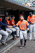 DETROIT, MI - MAY 21: Jose Altuve #27 of the Houston Astros is greeted by teammates in the dugout before the game against the Detroit Tigers at Comerica Park on May 21, 2015 in Detroit, Michigan. The Tigers defeated the Astros 6-5 in 11 innings. (Photo by Joe Robbins) *** Local Caption *** Jose Altuve