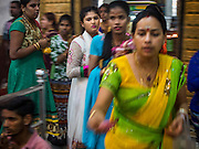 "22 OCTOBER 2015 - YANGON, MYANMAR: Hindus participate in a procession to honor the goddess Durga on the last day of Navratri in the Sri Kali temple in Yangon. Navratri, literally ""nine nights"" is a Hindu festival devoted to the Goddess Durga. Navratri festival combines ritualistic puja (prayer) and fasting. Navratri in India follows the lunar calendar and is celebrated in September/October as Sharad Navratri. It's widely celebrated in countries in Southeast Asia that have large Hindu communities, including Myanmar (Burma). Many of Myanmar's Hindus are descendants of Indian civil servants and laborers who came to Myanmar when it was the British colony of Burma.   PHOTO BY JACK KURTZ"