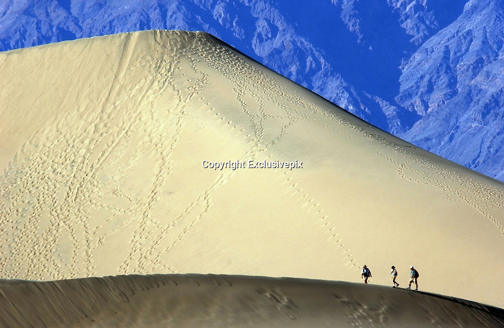 Apr 19, 2008 - Death Valley, California, USA - Visitors to Death Valley National Park climb the sand dunes near Stovepipe Wells. <br /> ©ZP/Exclusivepix