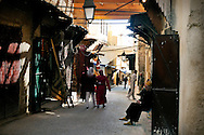 Morocco, Fez. People in the street of the medina.