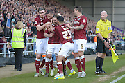 Northampton Town Striker Ricky Holmes celebrates scoring the first goal with his team mates during the Sky Bet League 2 match between Northampton Town and Notts County at Sixfields Stadium, Northampton, England on 2 April 2016. Photo by Dennis Goodwin.