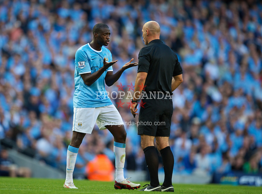 MANCHESTER, ENGLAND - Sunday, September 22, 2013: Manchester City's Yaya Toure argues wiry referee Howard Webb during the Premiership match against Manchester United at the City of Manchester Stadium. (Pic by David Rawcliffe/Propaganda)
