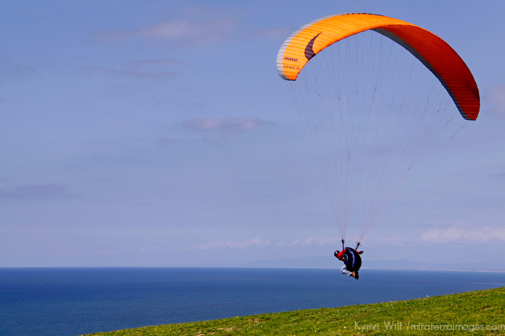 USA, California, San Diego. Paraglider taking off at Torrey Pines.