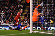 Fernando Torres shoots and scores the first goal past Chelsea's Petr Cech during the Barclays Premier League match between Liverpool and Chelsea at Anfield on February 1, 2009 in Liverpool, England.