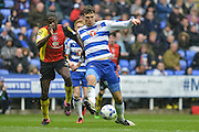 Reading FC defender (35) Jake Cooper shields the ball from Birmingham City striker (9) Clayton Donaldson during the Sky Bet Championship match between Reading and Birmingham City at the Madejski Stadium, Reading, England on 9 April 2016. Photo by Mark Davies.