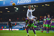 Barry Douglas of Leeds United (3) rises above Niclas Eliasson of Bristol City (19) to head clear during the EFL Sky Bet Championship match between Leeds United and Bristol City at Elland Road, Leeds, England on 24 November 2018.