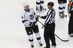 Dec 23, 2011; San Jose, CA, USA; Los Angeles Kings right wing Justin Williams (14) reacts in front of NHL linesman Vaughan Rody (73) after being called for a penalty against the San Jose Sharks during the third period at HP Pavilion. San Jose defeated Los Angeles 2-1 in shootouts. Mandatory Credit: Jason O. Watson-US PRESSWIRE