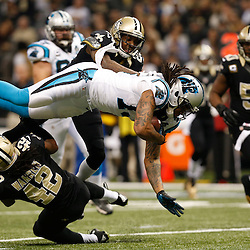 Dec 7, 2014; New Orleans, LA, USA; Carolina Panthers wide receiver Kelvin Benjamin (13) is upended by New Orleans Saints cornerback Keenan Lewis (28) and defensive back Pierre Warren (42) during the first quarter of a game at the Mercedes-Benz Superdome. Mandatory Credit: Derick E. Hingle-USA TODAY Sports