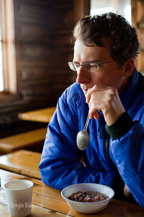 John Heisel contemplates life while eating breakfast at the Eiseman Hut near Vail, Colorado.