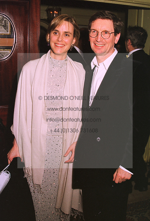 MR DAVID & the HON.MRS MONTGOMERY, he was former Chief Executive of the Mirror Group, at a party in London on 4th February 1999.MNY 24