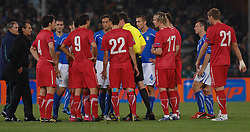 Players of Italy and Serbia leave the pitch after the UEFA EURO 2010 Group C qualifying match between Italy and Serbia was suspended at Luigi Ferraris Stadium on October 12, 2010 in Genoa, Italy.