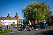 An electric cycling tour group stop to admire a traditional Oast house near Staplehurst, Kent, England, UK. Oast Houses are iconic in Kent and Surrey as they were used to store hops. (photo by Andrew Aitchison / In pictures via Getty Images)