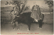 Male actor dressed as a Buddhist nun atop two actors dressed in an ox costume. Imperial Theater, Tokyo, ca. 1915, collotype postcard.<br />