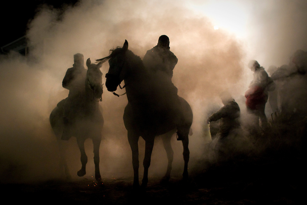 A man rides a horse through a bonfire in San Bartolome de Pinares, Spain, on Sunday, Jan. 16, 2011, during a traditional festival in honor of Saint Anthony, the patron saint of animals.