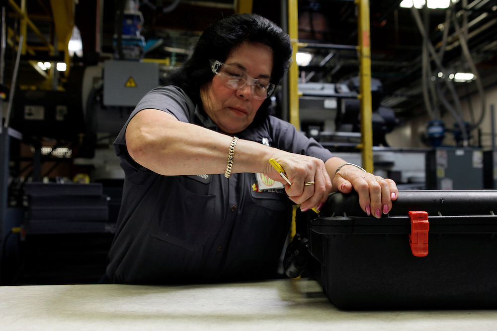 Workers assemble an injection-molded plastic hardshell case at the Pelican Products Inc. production facility in Torrance, California, U.S., on Thursday, March 8, 2012. © 2012 Patrick T. Fallon
