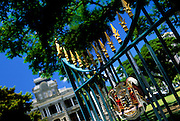 Image of the gates of the Iolani Palace and the Royal Crest of Arms, Honolulu, Oahu, Hawaii, America West.