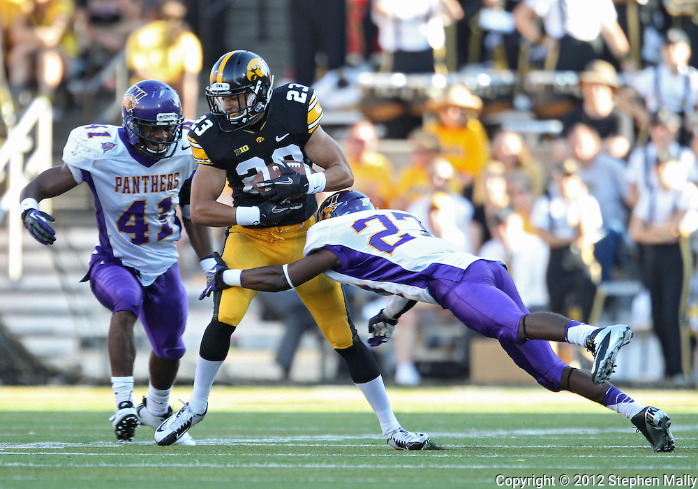 September 15 2012: Iowa Hawkeyes wide receiver Jordan Cotton (23) is hit by Northern Iowa Panthers defensive back Edwin Young (27) as linebacker Sam Tim (41) closes in during the second half of the NCAA football game between the Northern Iowa Panthers and the Iowa Hawkeyes at Kinnick Stadium in Iowa City, Iowa on Saturday September 15, 2012. Iowa defeated Northern Iowa 27-16.