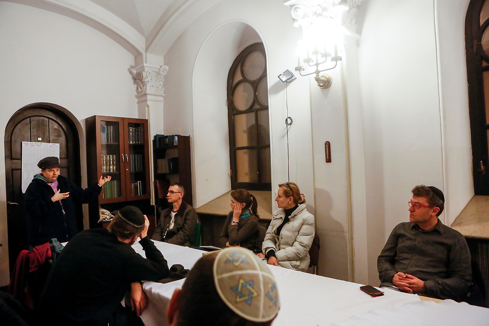 Miriam Gonczarska seen teaching a lesson in Judaism inside the Nożyk Synagogue, the only surviving prewar Jewish house of prayer in Warsaw, Poland, built in 1898-1902 and restored after World War II. The synagogue is still operational and currently houses the Warsaw Jewish Community, as well as other Jewish organizations. September 24, 2013. Photo by Miriam Alster/FLASH90