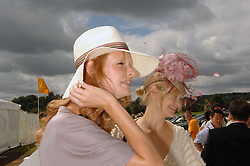 Left to right, OLIVIA INGE and ALEXIA INGE at the final of the Veuve Clicquot Gold Cup 2007 at Cowdray Park, West Sussex on 22nd July 2007.<br />