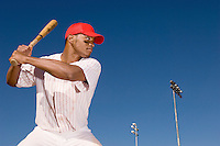 Baseball batter preparing to hit ball
