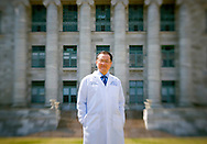 (Boston, MA - April 12, 2006)  - Dr. Jim Kim, a physician-anthropologist, is a Founding Trustee of Partners In Health and Co-Chief of the Division of Social Medicine and Health Inequalities at the Brigham and Women's Hospital in Boston. He is also Associate Professor of Medicine and Medical Anthropology and Director of the Program in Infectious Disease and Social Change at Harvard Medical School, and was photographed in the quad of the Harvard Medical School. Staff Photo Justin Ide/Harvard University News Office