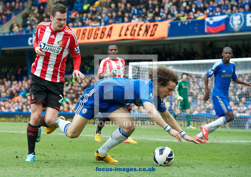 Picture by Alan Stanford/Focus Images Ltd +44 7915 056117.07/04/2013.David Luiz of Chelsea is fouled by Adam Johnson of Sunderland during the Barclays Premier League match at Stamford Bridge, London.