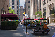 "Jeff Koon's ""Seated Ballerina"" inflatable sculpture at Rockefeller Center."