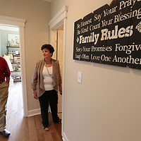 Benny Waycaster, left, and his wife, Martha, tour the St. Jude Dream Home they recently won on Rowan Oak Drive in Tupelo.