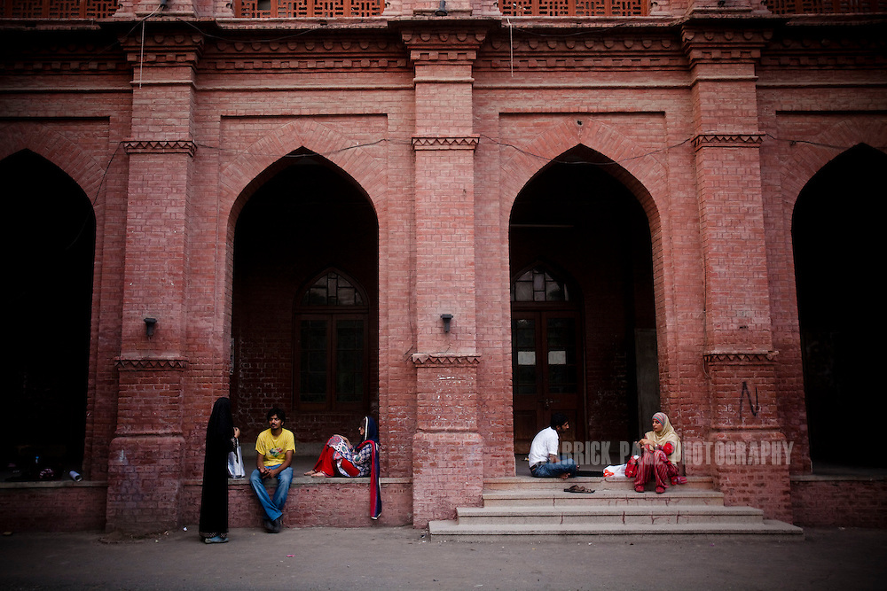 Male and female students talk outside Punjab University's old campus on July, 2011, in Lahore, Pakistan. Islamic groups are using increasing intimidation tactics in universities against progressive liberal youth throughout universities in Pakistan. (Photo by Warrick Page)