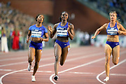 Dina Asher-Smith (GBR), center, celebrates after defeating Shelly-Ann Fraser-Pryce (JAM), left, and Dafne Schippers (NED) to win the women's 100m in 10.88 during the IAAF Diamond League final at the 44th Memorial Van Damme at King Baudouin Stadium, Friday, Sept. 6, 2019, in Brussels, Belgium. (Jiro Mochizuki/Image of Sport)