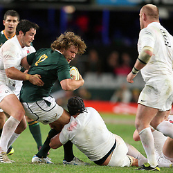 DURBAN, SOUTH AFRICA - JUNE 09, Frans Steyn is held by Brad Barritt during the 1st Castle Lager Incoming Tour test match between South Africa and England from Mr Price Kings Park on June 09, 2012 in Durban, South Africa<br /> Photo by Steve Haag / Gallo Images