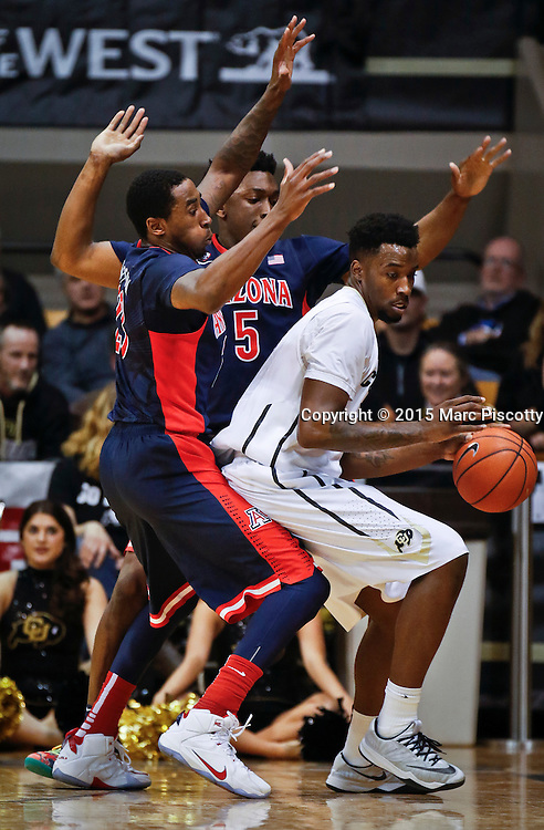 SHOT 2/26/15 9:45:59 PM - Arizona's Stanley Johnson #5 and Rondae Hollis-Jefferson #23 trap Colorado's Wesley Gordon #1 during their regular season Pac-12 basketball game at the Coors Events Center in Boulder, Co. Arizona won the game 82-54.<br /> (Photo by Marc Piscotty / &copy; 2015)