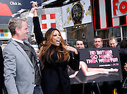 Wendy Williams and Dan Matthews appear to unveil PETA Campaign poster in Times Square in New York City, New York on November 28, 2012.