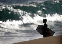 20 June 2006: A boogie boarder checks out the set as a  South swell reaches the famous surf spot in Newport Beach, CA called The Wedge.  Surfers, boogie boarders, body surfers and crowds gather to watch the powerful waves and the waters take shape into unique sets along the jetty in Orange County, California.