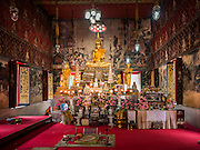27 JUNE 2015 - BANGKOK, THAILAND:  Inside the Wiharn (prayer hall) at Wat Kamphaeng near Khlong Bang Luang. The Bang Luang neighborhood lines Khlong (Canal) Bang Luang in the Thonburi section of Bangkok on the west side of Chao Phraya River. It was established in the late 18th Century by King Taksin the Great after the Burmese sacked the Siamese capital of Ayutthaya. The neighborhood, like most of Thonburi, is relatively undeveloped and still criss crossed by the canals which once made Bangkok famous. It's now a popular day trip from central Bangkok and offers a glimpse into what the city used to be like.       PHOTO BY JACK KURTZ