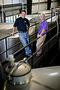 Dave and Jonathan Fussell of Duplin Winery, pictured on the catwalk above the tanks in the production facility.