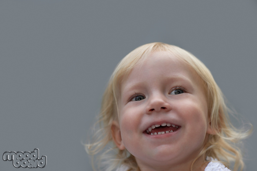 Portrait of young girl (3-4) laughing