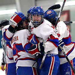 TORONTO, ON - Feb 16 : Ontario Junior Hockey League Game Action between the Milton Ice Hawks and the Toronto Jr. Canadiens, Toronto Junior Canadians Hockey Club celebrate the goal during first period game action.<br /> (Photo by Brian Watts / OJHL Images)