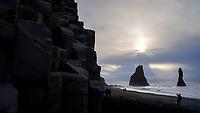 Reynisfjara beach, southcoast of Iceland. Tourists walking on the beach.