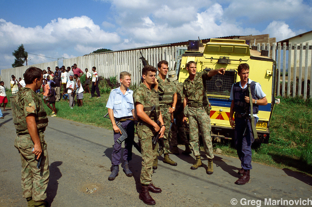Police react during ANC / IFP clash Richmond Farm Squatter Settlement Natal, South Africa, 1994