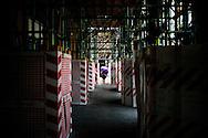 L'Aquila, Italia - 31 marzo 2013. Una veduta del centro storico dell'Aquila. Sono centinaia e centinaia i palazzi puntellati. Nella foto uno dei rari passanti che si incontrano passeggiando per le strade del centro del capoluogo abruzzese..Ph. Roberto Salomone Ag.Controluce