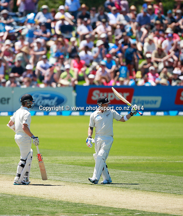 Brendon McCullum of the Black Caps raises his batt after passing 1000 runs in a calendar year while batting with Kane Williamson on Day 1 of the boxing Day Cricket Test Match  the Black Caps v Sri Lanka at Hagley Oval, Christchurch. 26 December 2014 Photo: Joseph Johnson / www.photosport.co.nz