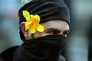 Copyright © 2004 Jeremy Hogan - All Rights Reserved..A Black Bloc Anarchist wears a flower during the IMF and World Bank protests Washington D.C. on April 16, 2000. ..anti-Globalization, globalisation, globalization, protest, protesters, flower, peaceful, peace, anarchist, anarchy,
